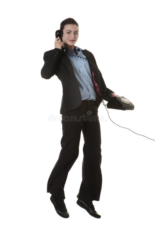 Femme sautante d'affaires photo libre de droits