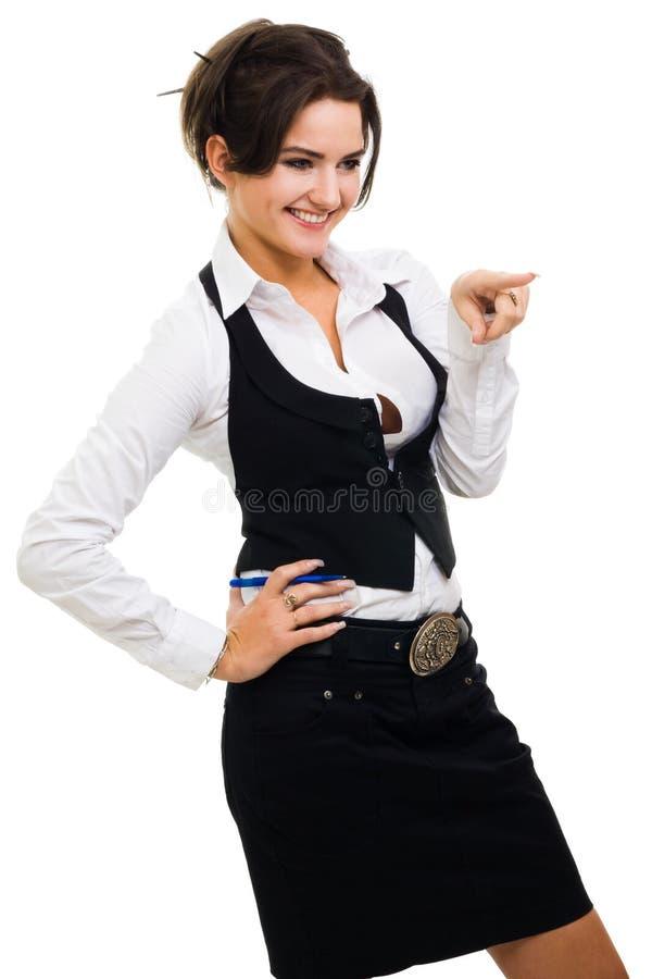 Femme se dirigeant avec le doigt et les FO s'usantes riantes photographie stock libre de droits