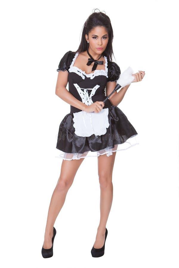 Femme sensuelle dans les domestiques bien justes uniformes photos libres de droits