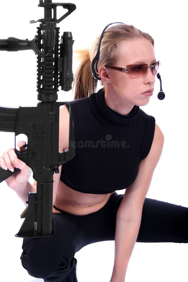 Femme sexy avec des canons photographie stock libre de droits