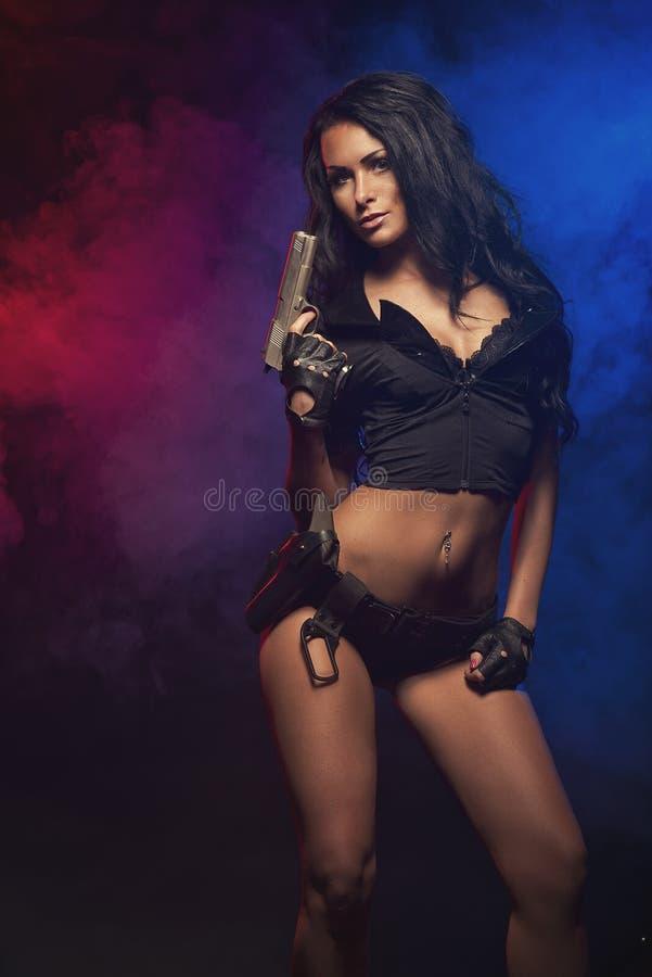 Femme sexy avec l'uniforme de police photo stock