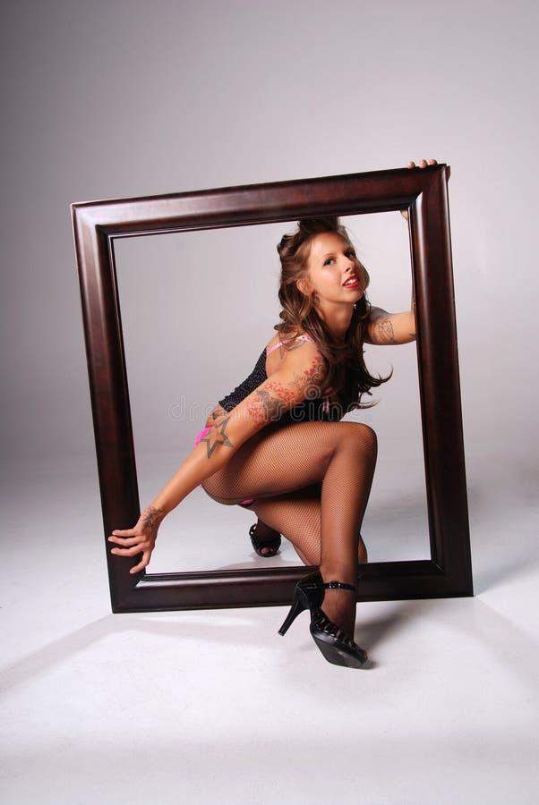 Femme sexy avec la trame. images stock