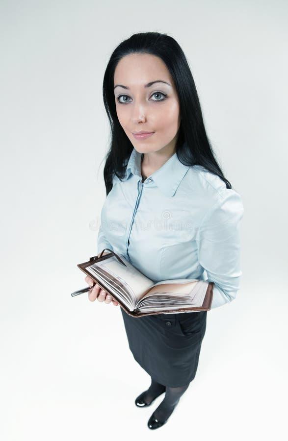 Femme sexy d'affaires de brunette avec l'agenda image libre de droits