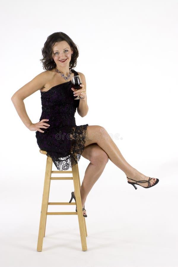 Femme sexy dans la robe de cocktail image libre de droits