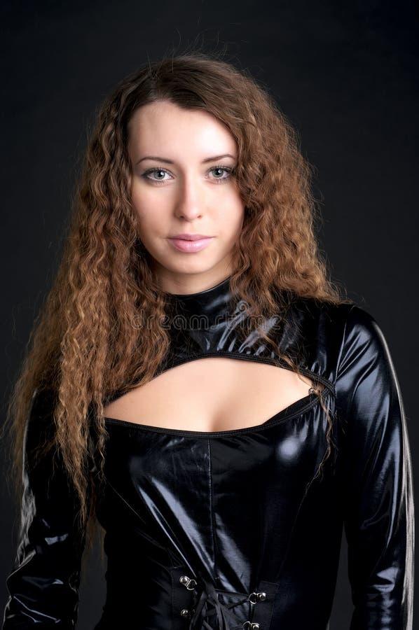 Femme sexy dans le latex collant images stock