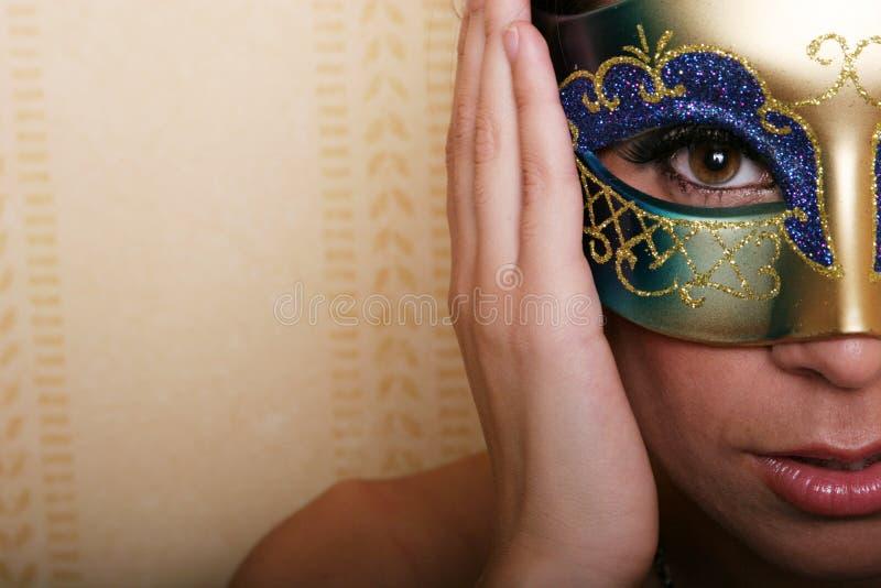 Femme sexy dans le masque photographie stock
