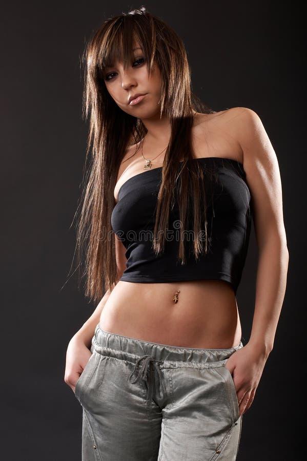 Femme sexy dans le studio photo libre de droits