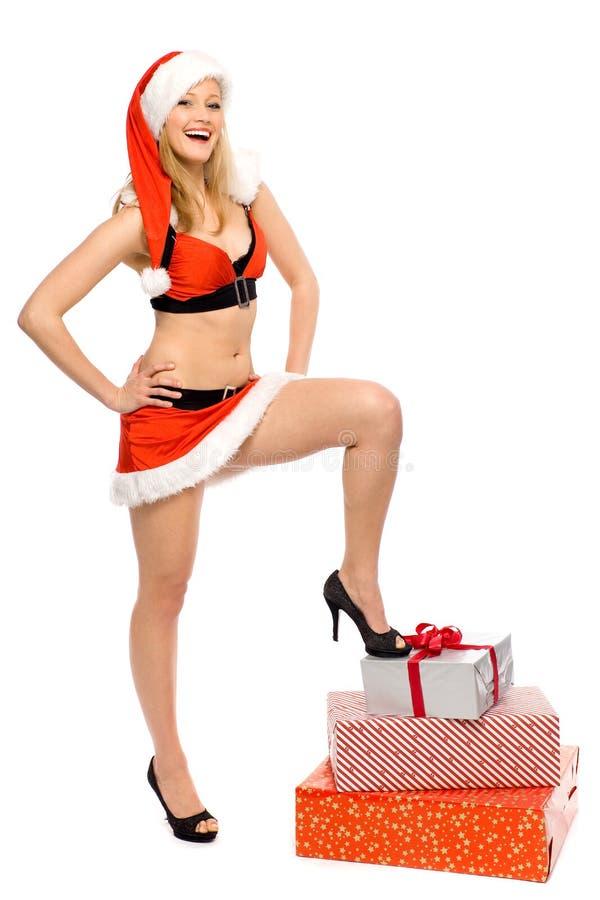 Femme sexy de Santa avec des présents photos stock