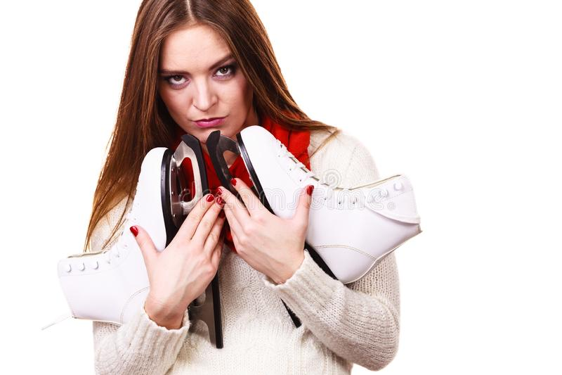 Femme songeuse avec des patins de glace photo libre de droits