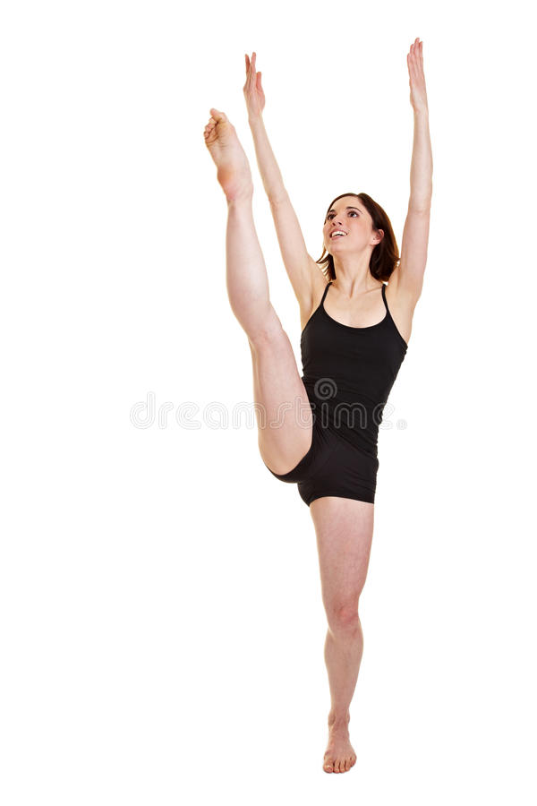 Femme soulevant sa patte vers le haut image stock