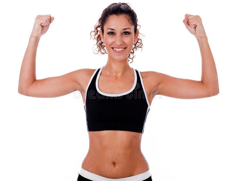 Femme soulevant ses mains faisant des exercices image stock