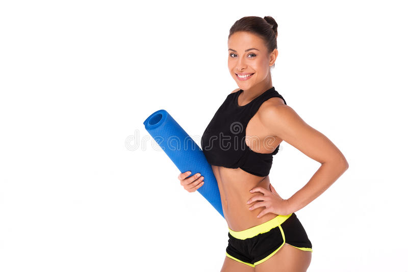 Femme sportive de métis avec la couverture de sport photographie stock