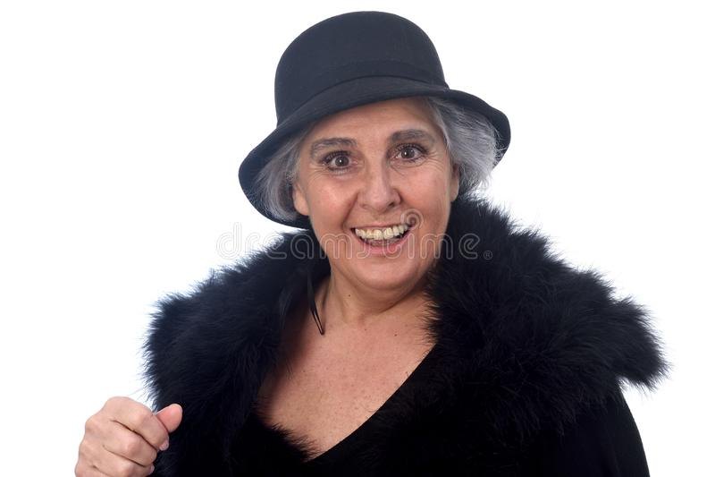 Femme supérieure avec le chapeau sur le fond blanc images libres de droits