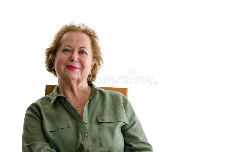 Femme supérieure de sourire sur le fond blanc photographie stock