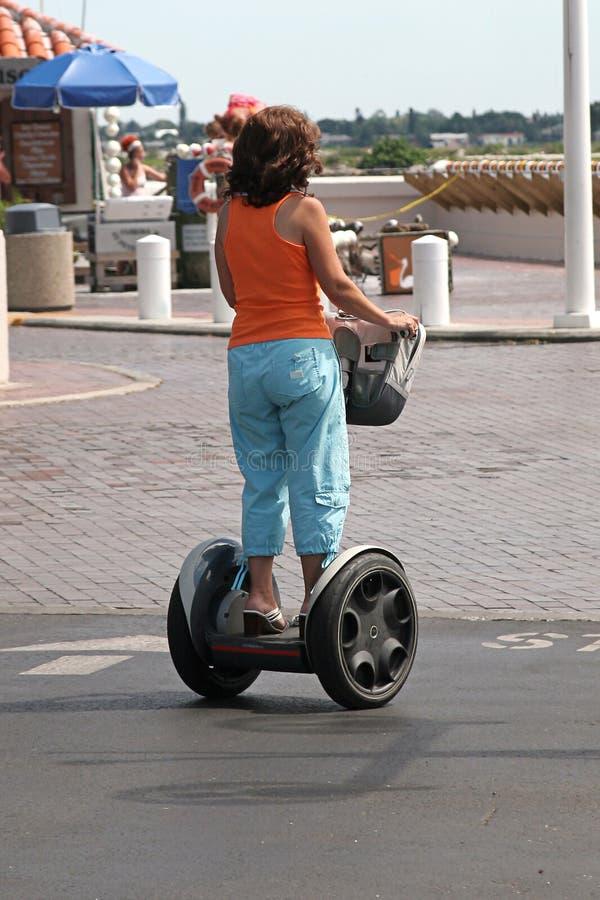 Femme sur le scooter électrique images stock