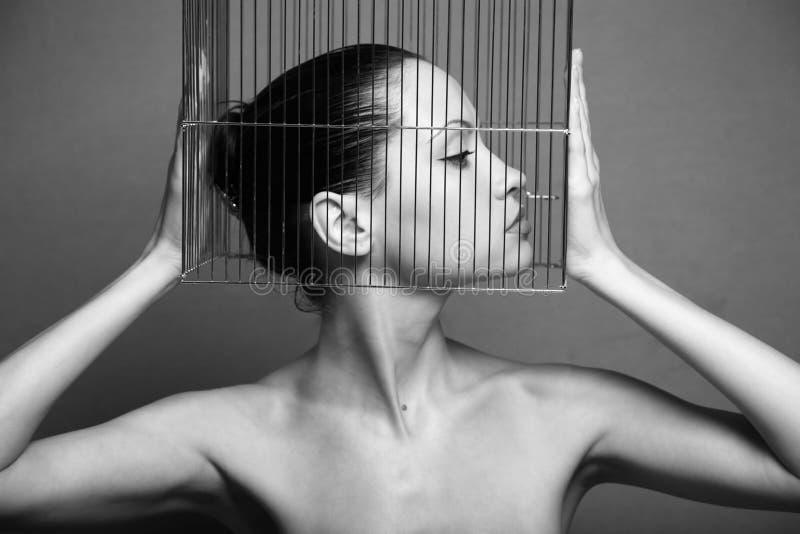 Femme surréaliste avec la cage photo libre de droits