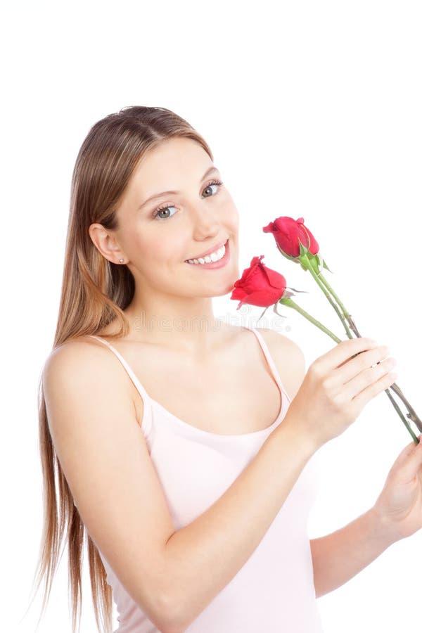 Femme tenant deux Rose image libre de droits