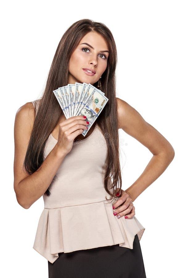 Femme tenant dollars US image libre de droits