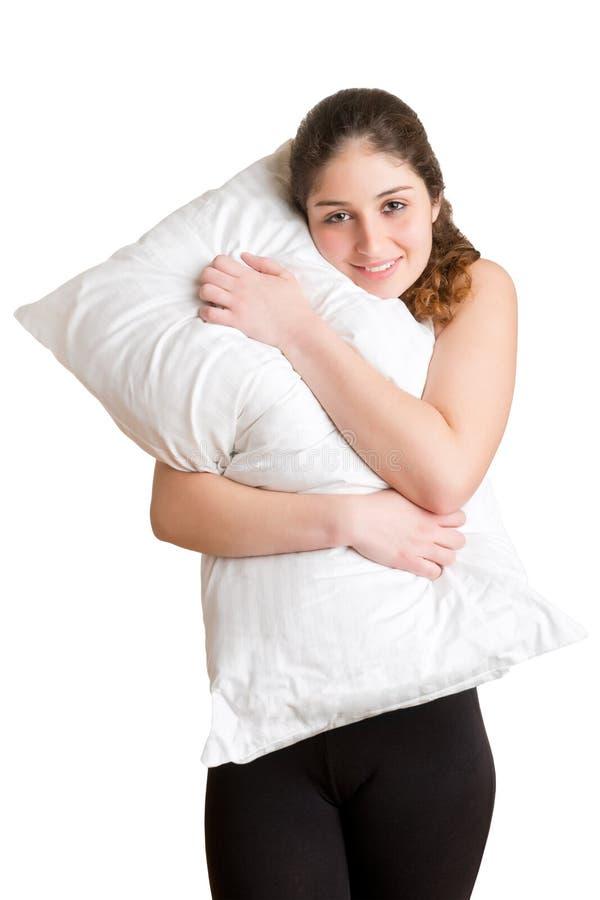Femme tenant l'oreiller photographie stock libre de droits