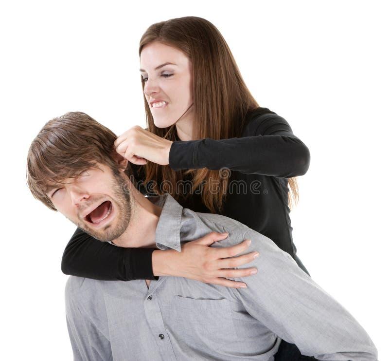 Femme tirant sur une oreille images libres de droits