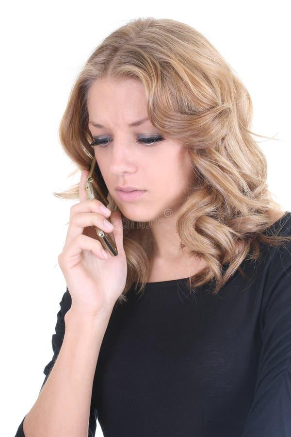 Femme triste parlant par le téléphone image stock