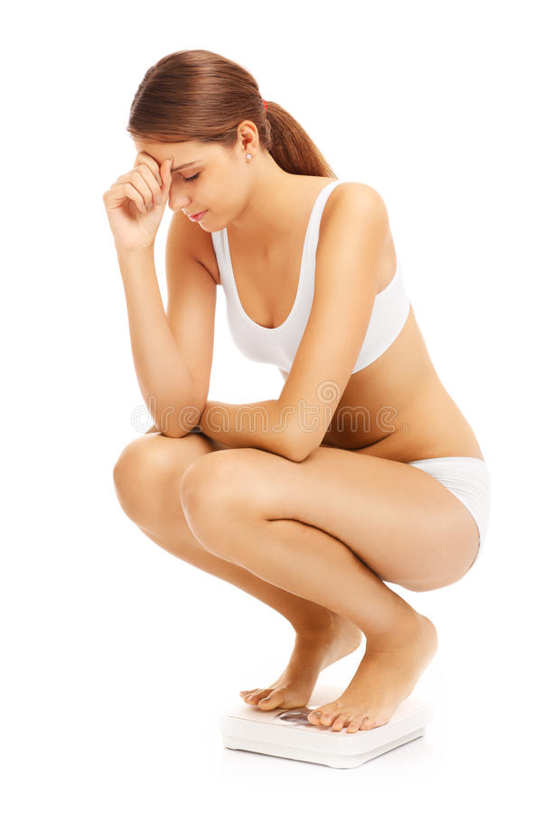 Femme triste sur des échelles de salle de bains photos libres de droits