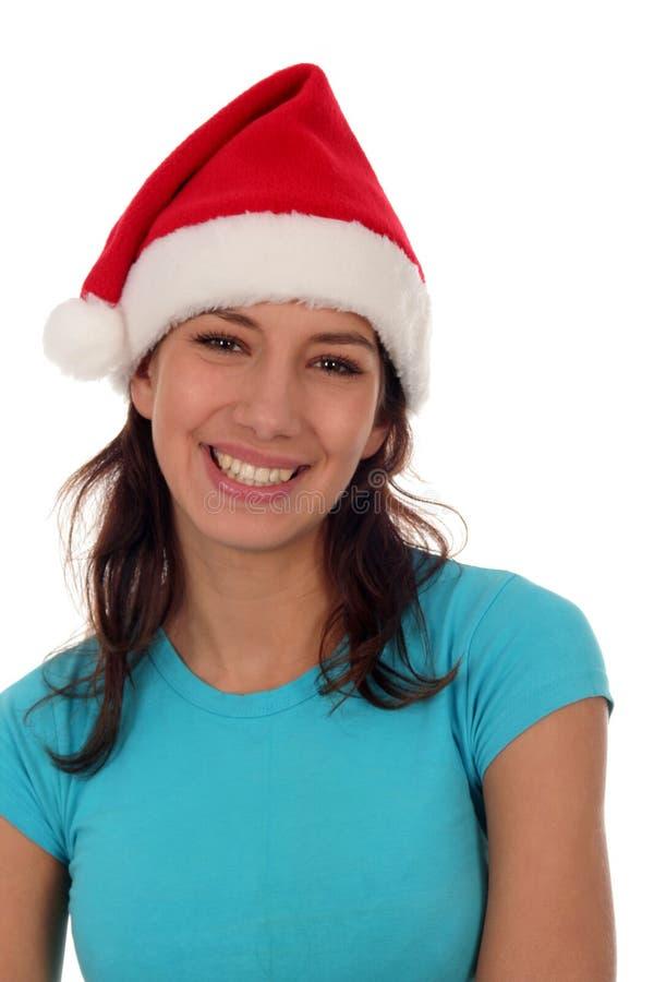 Femme utilisant un chapeau de Santa images stock