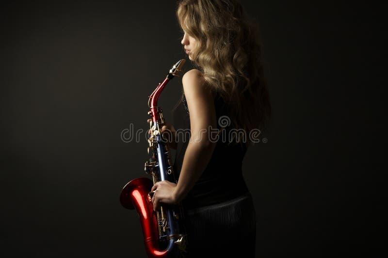 Femmes attirantes sexy avec le saxophone photos stock