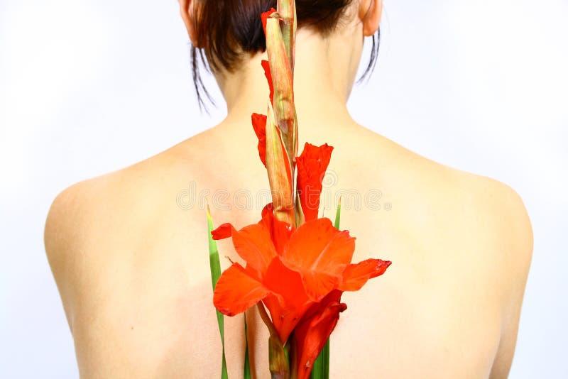 Femmes avec la fleur photographie stock