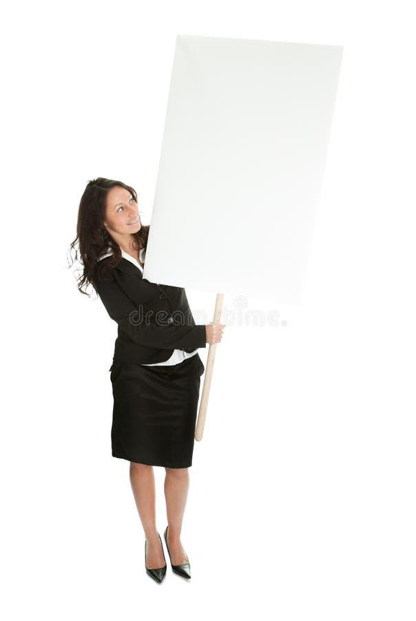 Femmes d'affaires gaies présent le panneau vide photos libres de droits