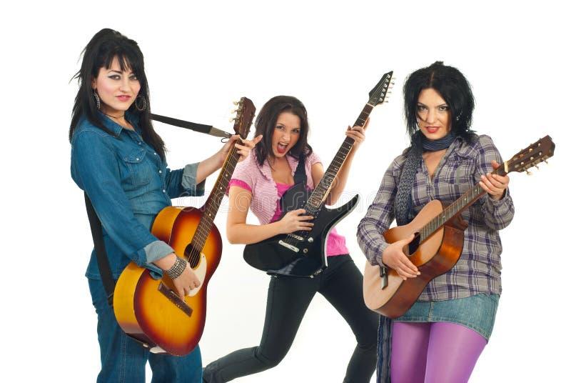 Femmes de bande de guitaristes de roche photos stock