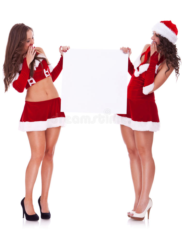 Femmes de Santa retenant un panneau blanc image libre de droits