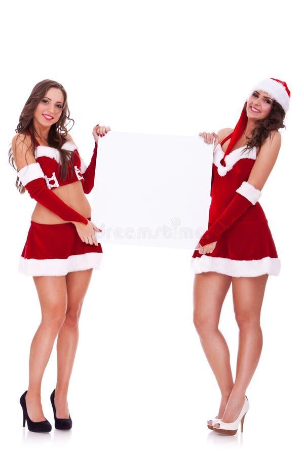 Femmes de Santa retenant un panneau blanc photos libres de droits
