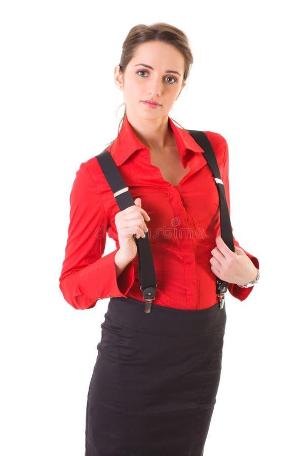 Femmina attraente in camicia rossa ed in parentesi graffe, isolate fotografie stock