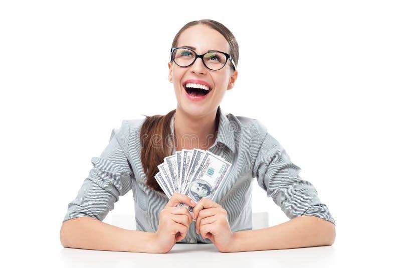 Femmina che tiene un fan di soldi fotografia stock