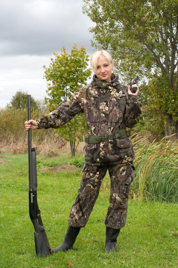 Femmina con la pistola. immagini stock libere da diritti