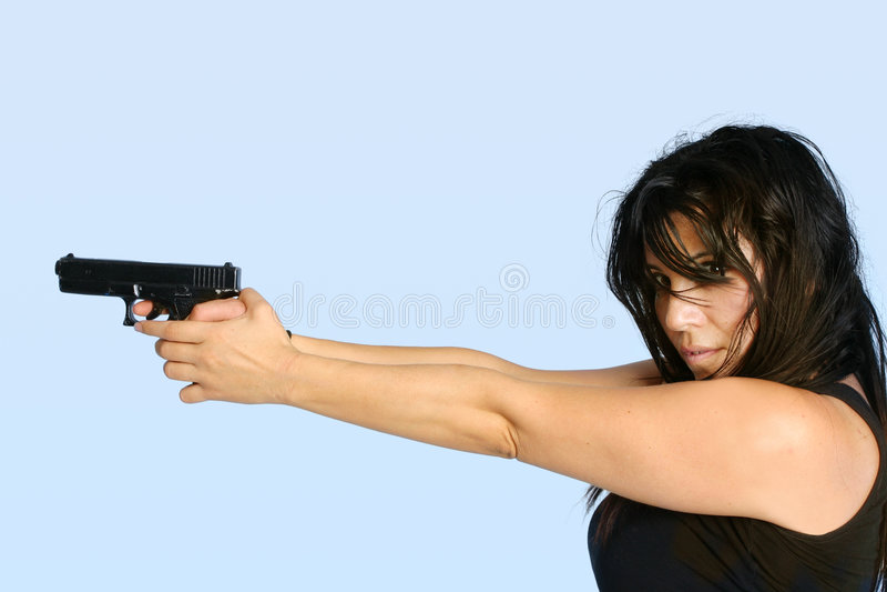 Femmina con una pistola immagini stock