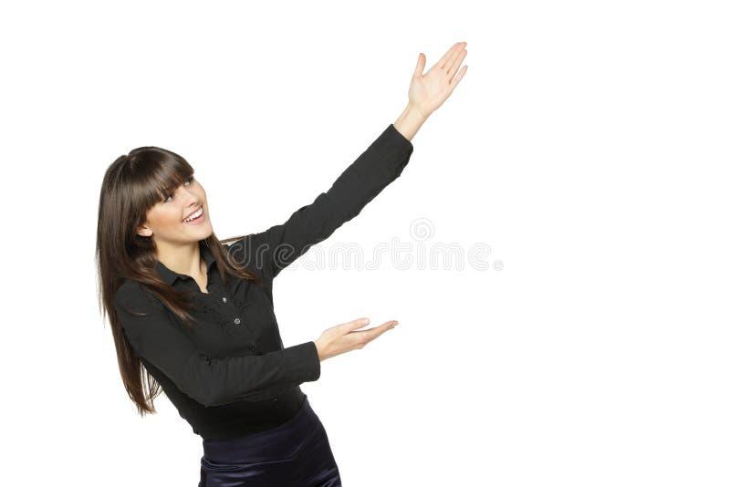 Femmina emozionante che mostra spazio in bianco immagini stock libere da diritti