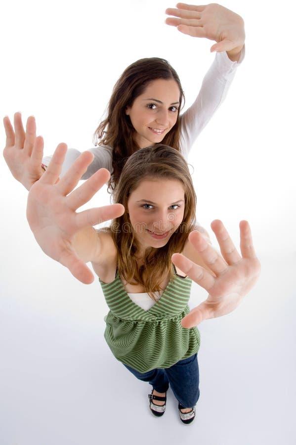 Femmina felice che mostra le loro palme fotografia stock libera da diritti