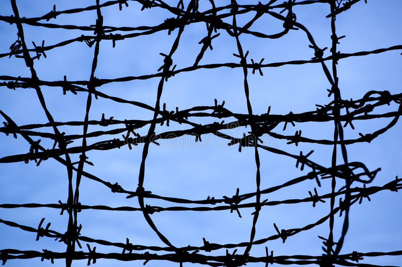 Fence. Sky covered fence of a prison royalty free stock photos
