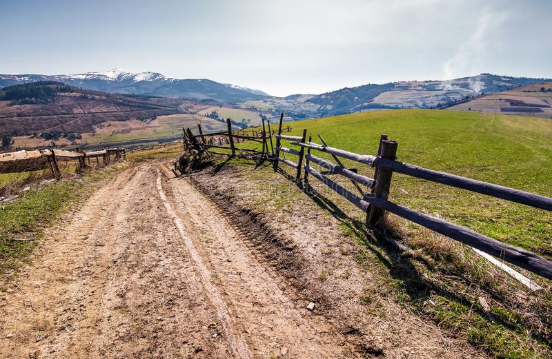 Fence along the country road in rural area stock photos