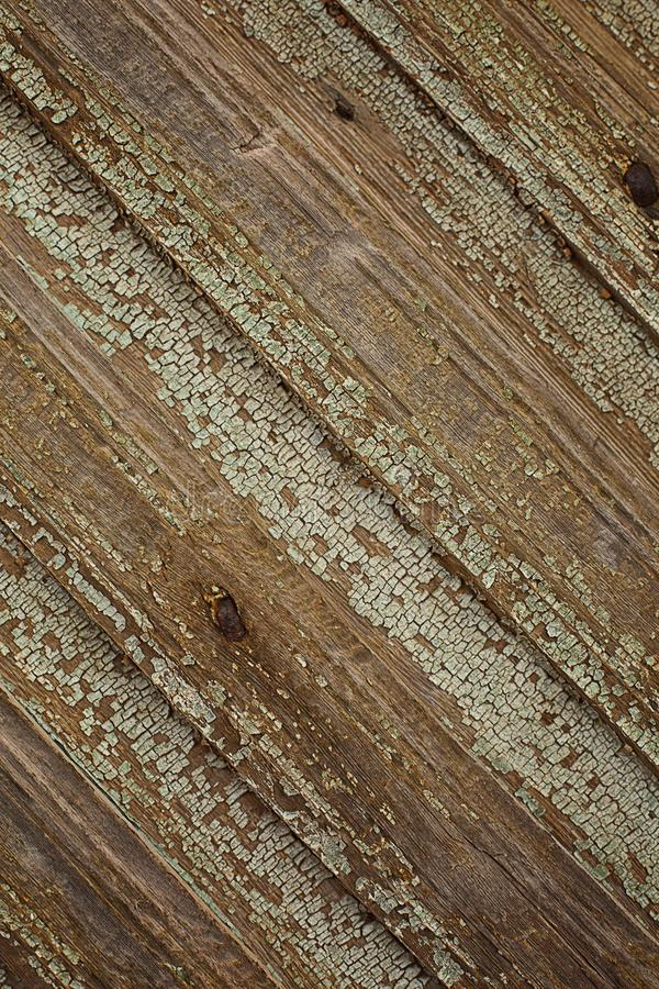 Fence background old rustic dark brown and green craquelure gra. Fence background old wooden texture rustic dark brown and green craquelure gradient of boards royalty free stock photos