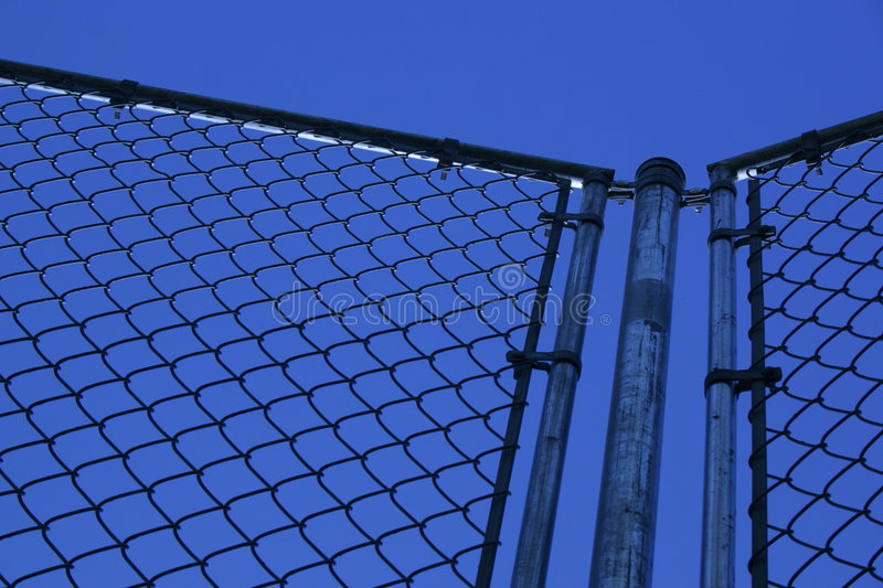Fence and blue sky royalty free stock photo
