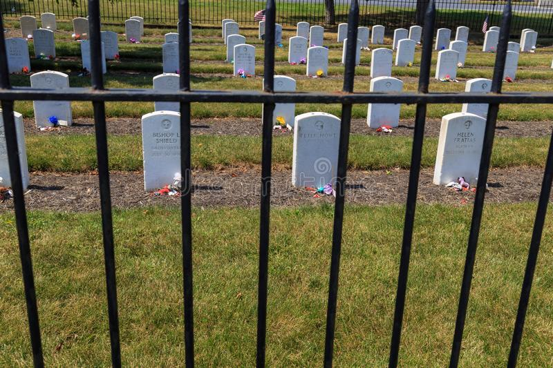 Fence at Carlisle Indian Industrial School Graves. Carlisle, PA, USA - June 26, 2016: Graves of Native American youths that attended the Carlisle Indian royalty free stock photo