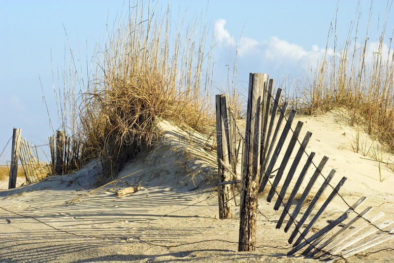 Fence in Dunes stock images