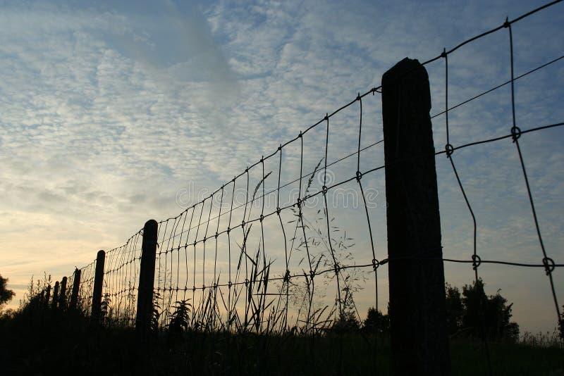 Fence At Dusk Stock Photos