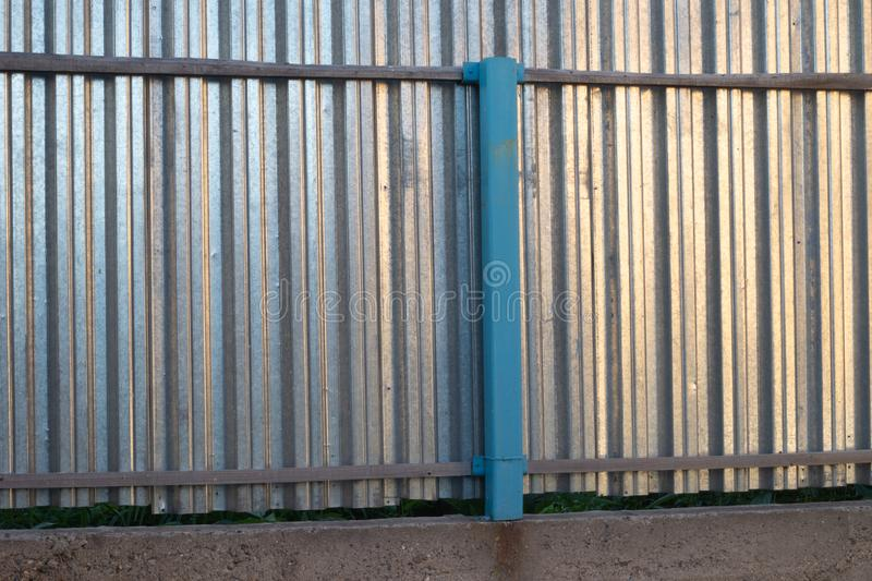 Fence. FENCING FROM METAL ON CONCRETE FOUNDATION royalty free stock photography