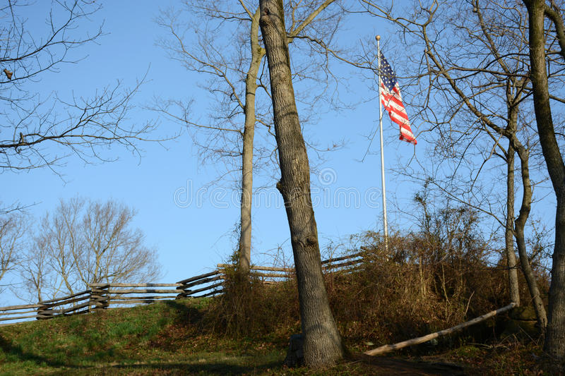 Fence with flag stock photography