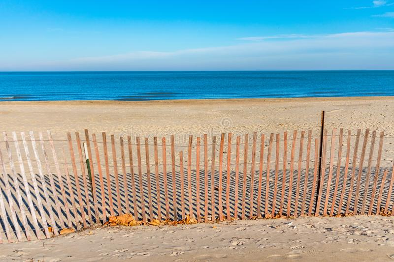 Fence at Foster Beach in Chicago with Lake Michigan royalty free stock photos