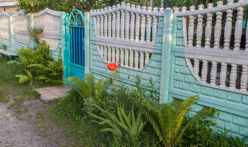 Fence and gate house in the village. In Ukraine stock image